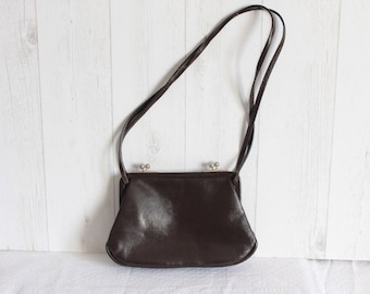 Brown genuine leather handbag. 50's. Viale RIA. PARIS. France.