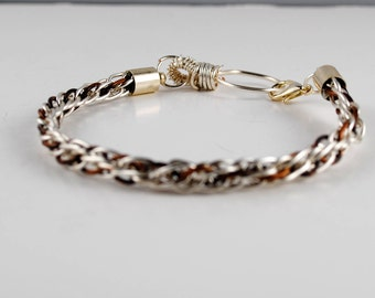 Kumihimo wire bracelet braided with  silver and antique bronze coloured wire and finished with silver plate end caps