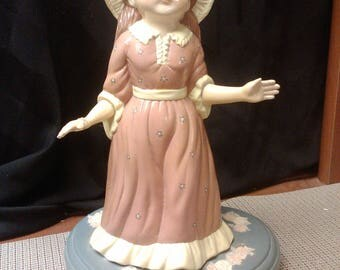 Girl on heart base coin bank mid-1900s