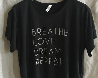 2.6 Solid Black Relaxed Fit Crop Tee. Eco-Friendly. Yoga. Zen. Chill. Comfy. Wanderlust. Festival. Breathe. Love. Dream