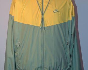 Nike light weight cagoule jacket UK Men's size large.  Two tone Nike tracksuit top