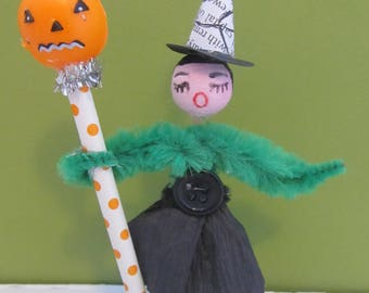Retro style Halloween witch doll with vintage spun cotton head, pumpkin straw adornment on poker chip