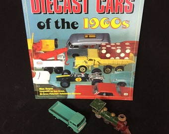 Diecast Cars of the 1960s Guide plus Two Vintage Diecast Vehicles