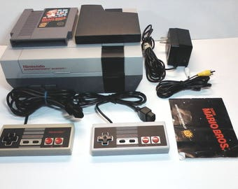 Original NES Nintendo Entertainment System Console, New Socket, Lockout Chip Disabled, 2 Controllers, AV cord, AC adapter, Super Mario Bros.