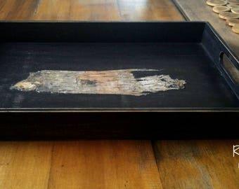 Natural wood serving tray.