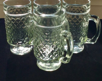 Vintage pressed depression glass footed beer mugs