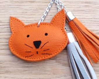 tassel and cat in orange and grey leather handbag