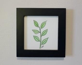 Small watercolor, branch, black frame