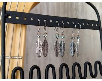 1.25-inch earrings with antiqued silver feather and accented with teal beads, choose a style