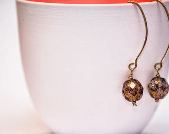 Gold hanging earrings with grey Golden Crystal bead