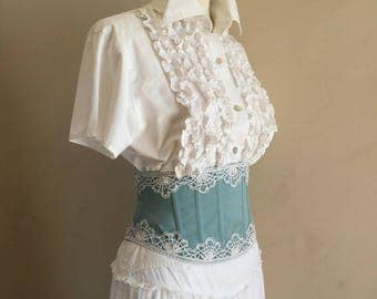 Greenhouse size, waist corset wide, blue and white lace.