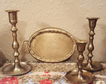 Vintage brass tray and candlestick collection.  3 brass candlesticks and one oval brass bamboo tray.  Boho brass colleciton.