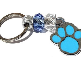 """Keychain featuring a dog paw print and two glass faceted rondelles: """"Paw"""" - blue"""