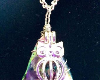 A Bead in a Cage - Silvertone owl cage w/multicolored bead and imitation abalone stone **FREE DOMESTIC SHIPPING**