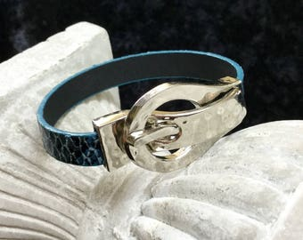 Bracelet with a jewel toned blue leather buckle