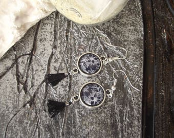 Small dangle earrings with silver hooks and round black and white flowers on black print glass cabochons