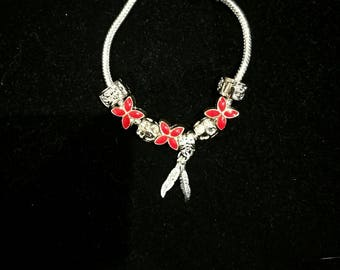 Red European bracelet with European beads, feathers