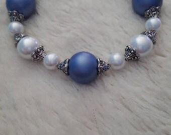 Handmade womens periwinkle and white beaded bracelet.