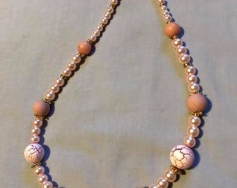 Pink faux pearl and glass bead necklace