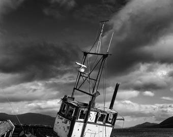A black & white photographic print of an old fishing wreck taken in Scotland
