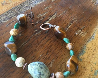 Fall Love! Beautiful Handmade Bracelet with semi-precious gemstones including African Turquoise, Jasper and Tigerseye. Copper Toggle Clasp.