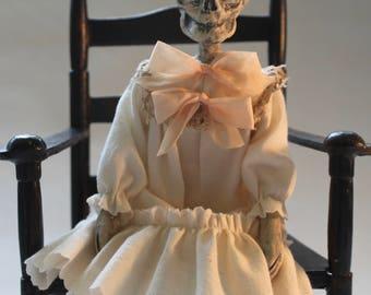 Vinegar Doll Cordelia by William Bezek, a dead Edwardian child fetal skeleton art doll.
