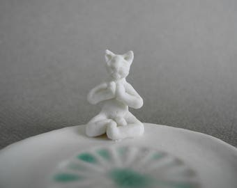 Porcelain incense holder for incense cones with a white namaste cat