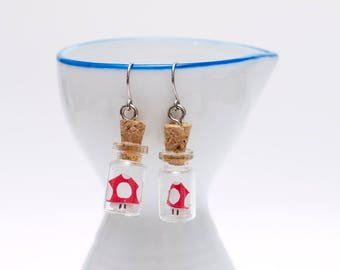 Origami Mario Bros red shroom earrings in tiny glass bottle