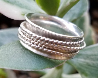 Sterling Silver Spinner Ring with four twisted spinners