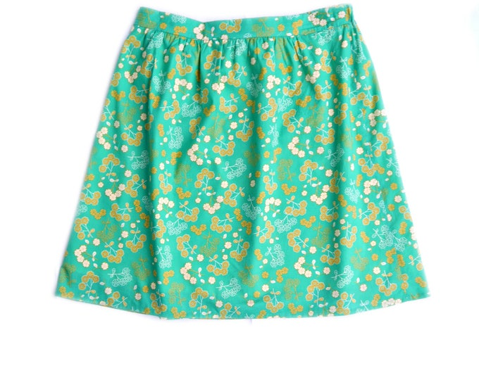 knee length, fully lined cotton skirt of green fabric with yellow flowers, back elastic waist, retro skirt, vintage style skirt