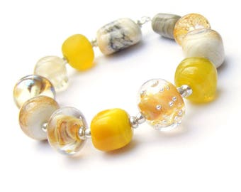 Handmade lampwork glass bead set of 12 mainly cream and yellow orphan beads - yellow renegades