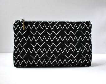 Black and white zig zag abstract canvas padded toiletry bag cosmetics travel makeup pouch turquoise lining XL extra large size.