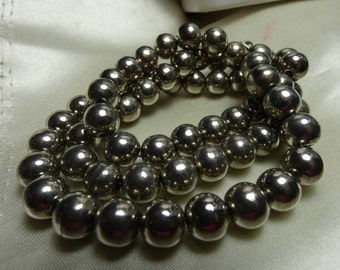 "Strand of 10mm nickel silver beads necklace. 51 grms-24"" long 2297"