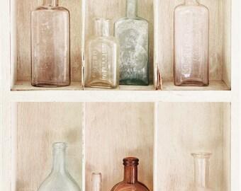 Antique bottles on shelf - vertical printed photograph