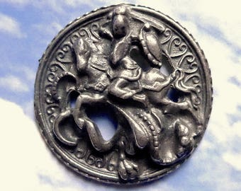 St George slaying the Dragon button, antique.   It is very 3 dimensional, a great design in pierced metal with a wedge shank . c19th. cent.