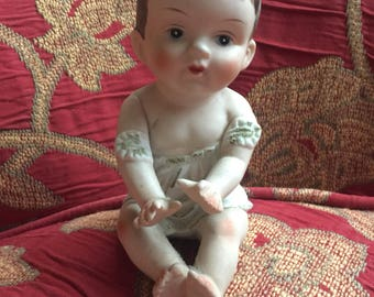 German Bisque Piano Baby Figurine by KPM
