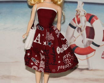 USA - Dress, Hat & Bag. Snaps. Fits dolls the size of old and new Barbies. Clothes only, Ponytail Barbie doll  is not included
