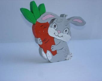 Naughty rabbit with carrot in puzzle wood