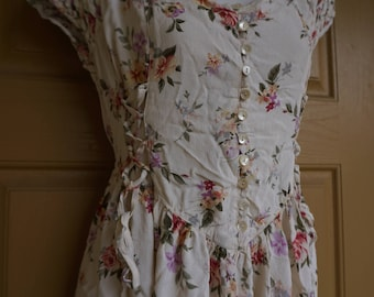 Vintage floral dress made by Rene Derhy with corset style laces on the sides labeled size L Large