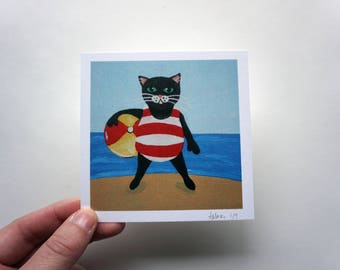 Black Cat at the Beach, Black Cat with Beach Ball Print by Amber Maki
