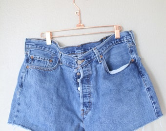 vintage 1980's distressed cut off levis 501 button fly  jean shorts  38