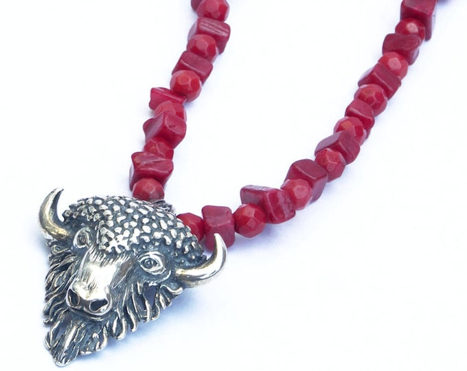 Necklace pendant with Taurus and coral beads