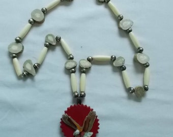 Necklace with bone and sterling beads and a leather/eagle pendant.  (649)