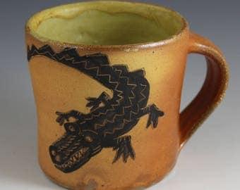Soda fired alligator mug