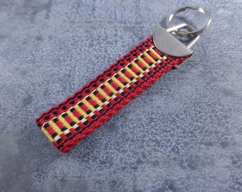 Handwoven fingertip keychain - Red and Yellow