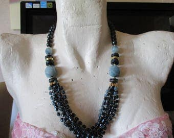 """vintage 23""""long necklace in goldtone /pale blue/dark blue with 8 rows of beads at front"""