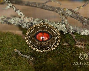 Dark brass dragon's eye