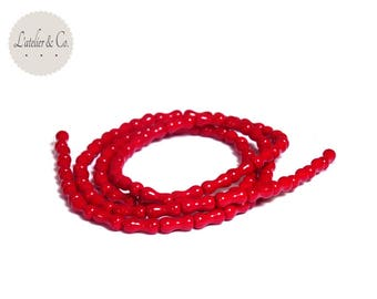 Bone beads 33 smooth 8x3mm dark red glass bone-19.