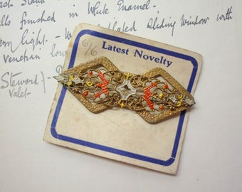 Antique brooch with original packaging