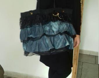 Ruffles with a rhinestone bow bag
